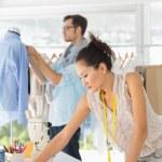 Fashion designers at work in bright studio — Stock Photo #42915627