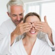 Happy man covering his partners eyes in the morning — Foto de Stock   #42915843