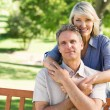 Woman embracing man from behind in park — Stock Photo #42916309