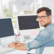 Side view portrait of a male artist using computer — Stock Photo #42917151