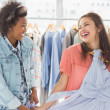 Happy women shopping in clothes store — Stock Photo #42917895