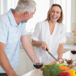 Laughing couple making dinner together — Stock Photo