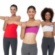 Portrait of three sporty young women stretching hands — Stock Photo #42918271