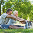 Couple stretching in the park — Stock Photo #42918783