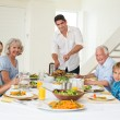 Father serving meal to family — Stock Photo #42919273