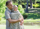 Loving couple embracing in park — Foto de Stock