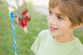 Boy looking at pinwheel — Stock Photo