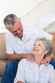 Man giving his senior wife a shoulder rub — Stock Photo