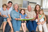 Family with storybook at home — Stock Photo