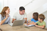Parents assisting children coloring — Stock Photo