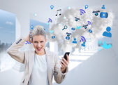 Businesswoman holding smartphone with cloud — Stock Photo