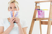 Woman holding color swatches — Stock Photo