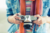 Woman looking at her camera — Stock Photo