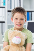 Boy with teddy bear in clinic — Stock Photo