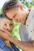 Man consoling woman in park — Stock Photo