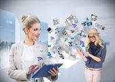 Businesswoman using tablet pc with app icons — Stock Photo