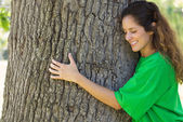 Environmentalist hugging tree trunk  — Stock Photo