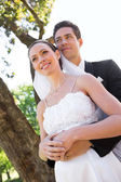 Newly wed couple in garden — Stock Photo