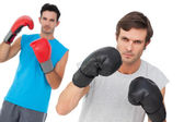 Portrait of two male boxers practicing — Stock Photo