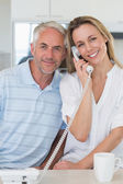 Happy man listening in on his blonde partners phone call — Stock Photo