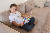 Girl reading storybook — Stock Photo
