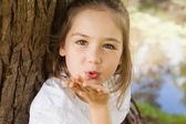 Girl blowing a kiss at park — Stock Photo