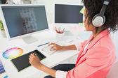Casual female photo editor using computer — Stock Photo