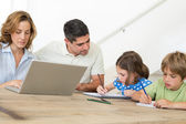 Father assisting children in coloring — Stock Photo