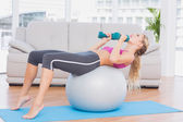 Blonde doing sit ups with exercise — Stock Photo