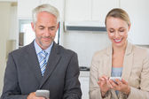Happy business couple texting before work in morning — Stock Photo
