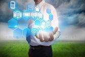 Affärsman presentera gränssnittsmenyn med apps — Stockfoto