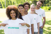 Environmentalist showing volunteer tshirt — Stock Photo