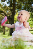 Cute happy baby holding with a box at park — Stock Photo