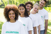 Volunteers standing in a line — Stock Photo