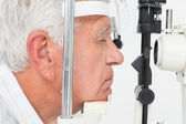 Senior man getting his cornea checked — Stock Photo