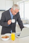 Focused businessman using laptop in the morning before work — Stock Photo