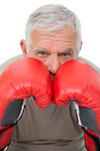Close-up portrait of a determined senior boxer — Stock Photo