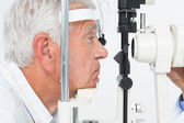 Senior man getting his cornea checked — Stock Photo
