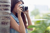 Girl taking photographs outside — Stock Photo