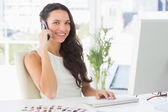 Beautiful editor talking on phone — Stock Photo