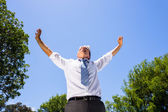 Businessman with arms outstretched — Stockfoto