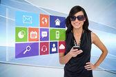 Glamorous brunette using smartphone with app icon menu — Stock Photo