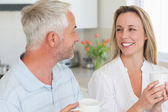 Smiling couple having coffee together — Stock Photo