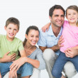 Cute family posing and smiling at camera together — Stock Photo