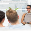 Therapist smiling at couple on the couch — Stockfoto