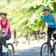 Cyclists riding bicycles — Stock Photo #42920303