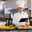 Chef using digital tablet — Stock Photo #42920997