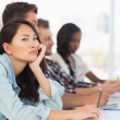Bored woman looking at camera during a meeting — Stock Photo