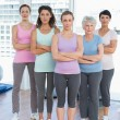 Confident women with arms crossed in yoga class — Stock Photo