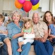 Family celebrating girls birthday — Stock Photo #42922505
